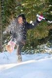 A cheerful woman kicks snow royalty free stock photos