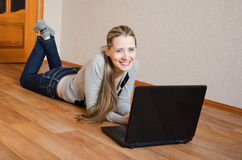 Cheerful woman  with the laptop Stock Image