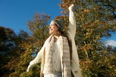 Cheerful woman laughing outdoors on a sunny fall day Royalty Free Stock Photos