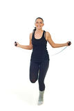 Cheerful woman leaping jump rope royalty free stock photography