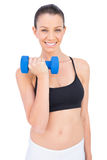 Cheerful woman lifting dumbbell Royalty Free Stock Images