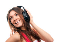 Cheerful woman listening and enjoying music Stock Images
