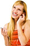 Cheerful woman listening MP3 Royalty Free Stock Photography