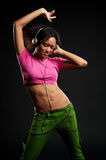 Cheerful woman listening music and dancing Stock Photo