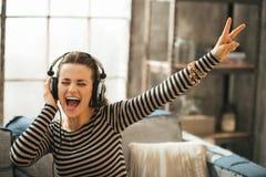 Cheerful woman listening music in headphones Stock Photos