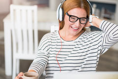 Cheerful woman listening to music Stock Photography
