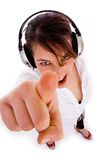 Cheerful woman listening to music in headphon Royalty Free Stock Photos