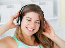 Cheerful woman listening to music with headphones Stock Photography