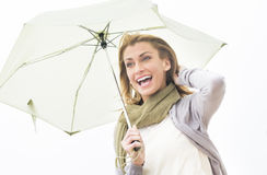Cheerful Woman Looking Away While Holding Umbrella Royalty Free Stock Photo