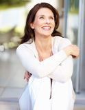 A cheerful woman looking away in thought Royalty Free Stock Images