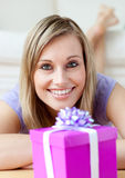 Cheerful woman looking at a gift royalty free stock photography