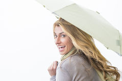 Cheerful Woman Looking Over Shoulder While Holding Umbrella Stock Image