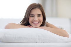 Cheerful woman lying on the bed Stock Photography