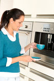 Cheerful woman making coffee machine kitchen cup Stock Images