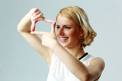 Cheerful woman making a hand frame Stock Photos