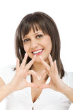 Cheerful woman making heart sign Royalty Free Stock Image