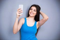 Cheerful woman making selfie photo Stock Photography