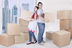 Cheerful woman and man carry box Stock Image