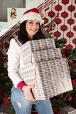 Cheerful woman with many presents Royalty Free Stock Image
