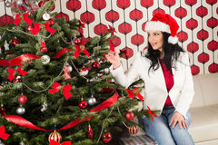 Cheerful woman  with natural Chrismas tree Royalty Free Stock Image