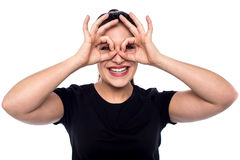 Cheerful woman in observe gesture Royalty Free Stock Photo