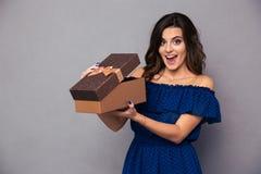 Cheerful woman opening gift box Stock Image