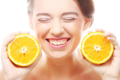 Cheerful woman with oranges in her hands Royalty Free Stock Images