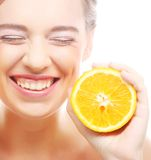 Cheerful woman with oranges in her hands Royalty Free Stock Photos