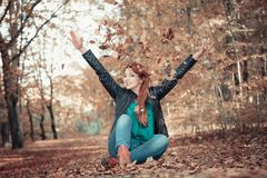 Cheerful woman in park royalty free stock photos