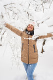Cheerful woman in park with snow Royalty Free Stock Photography