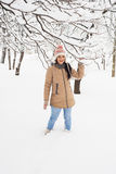 Cheerful woman in park with snow Royalty Free Stock Image