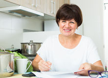 Cheerful woman paying bills Royalty Free Stock Photography