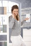 Cheerful woman on phone call at home Royalty Free Stock Photo