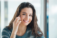 Cheerful woman on the phone Royalty Free Stock Images