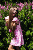 Cheerful woman in pink dress Royalty Free Stock Images