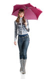 The cheerful woman  with a pink umbrella Stock Image