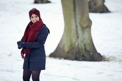Cheerful Woman Playing in the Snow Stock Photography