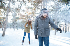 Cheerful woman playing snowballs with her boyfriend Royalty Free Stock Photography
