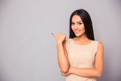 Cheerful woman pointing finger away Royalty Free Stock Photography