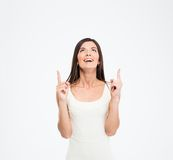 Cheerful woman pointing finger up Royalty Free Stock Photography