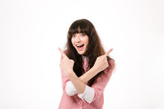 Cheerful woman pointing fingers away Royalty Free Stock Photos