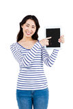 Cheerful woman pointing at tablet computer Stock Photo