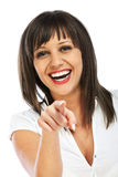 Cheerful woman points at camera Royalty Free Stock Photography