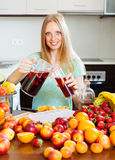 Cheerful woman pouring beverages   to glass Royalty Free Stock Images