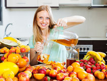 Cheerful woman pouring fresh beverages Royalty Free Stock Photo