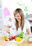 Cheerful woman preparing a healthy meal Stock Images