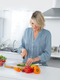 Cheerful woman preparing vegetables Royalty Free Stock Images