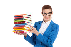 Cheerful woman presenting stack of books Stock Photography