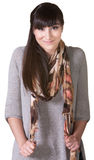Cheerful Woman Pulling On Scarf Royalty Free Stock Photos