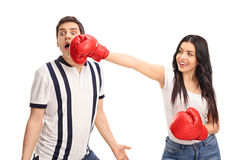 Cheerful woman punching her boyfriend Stock Image